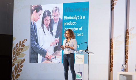 Anna Zhenchuk speaking at conference 2